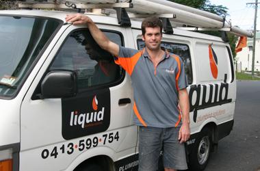 Bruce Sutton standing next to Liquid Plumbing Solutions van